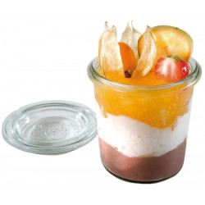 A glass jar with a lid,...
